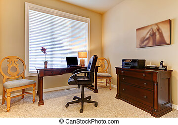 Home office with desk in beige colors