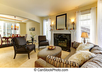 Elegent large golden living room with fireplace