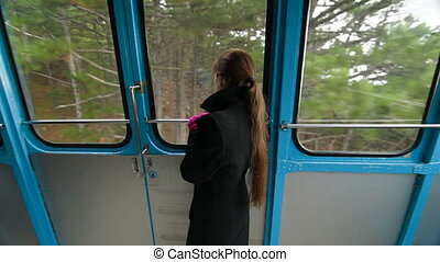 cable-car Ai-Petri - woman looks through the window cabin...