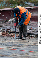 Workman with Jackhammer - Workman Using Jackhammer on Roof...