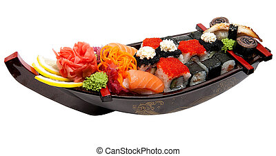 Set of sushi on wooden stand in the form of the boat...