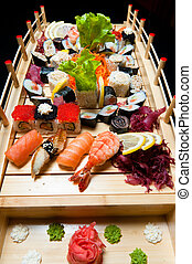 Set of sushi on wooden stand in the form of the bridge...