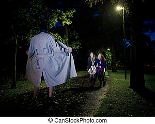 Flasher at night - Two women laughing at a Flasher at night...