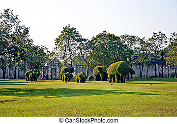 bushes cut to animal figures in the park of Bang Pa-In...