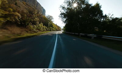Driving on winding mountain road - Driving on a winding...