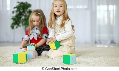 Children play with blocks of tissue