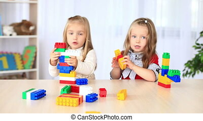 Children playing with a constructor - Childhood