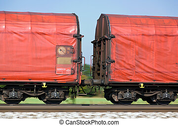 freight train on rails - the wagons of a goods train on...