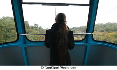 Cablecar ascending Ai-Petri - woman in the cabin the cable...