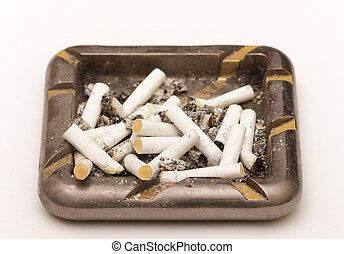 photo of ashtray with butts, closeup