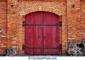 Red door in red brick wall