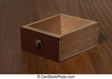 Small drawer on a wooden table - Small wooden drawer on a...