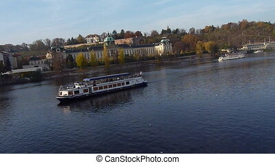 River in Prague - Boats are flowing on Vltava river in...