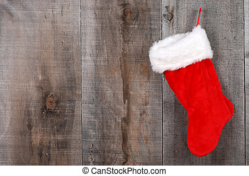 Christmas sock on wood - red Christmas stocking hanging on...