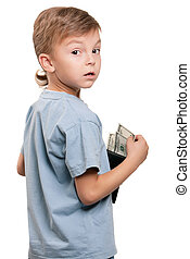 Boy with dollars - Portrait of a little boy holding a...
