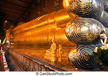 The giant Reclining Buddha in Wat Pho, Thailand - feet of...