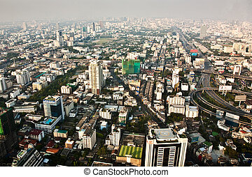 View across Bangkok skyline showing office blocks and...