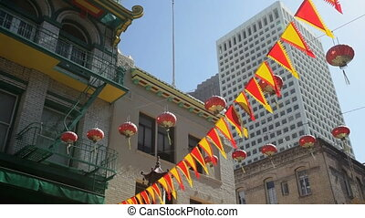 Chinatown lanterns - Flags and lanterns hanging above...