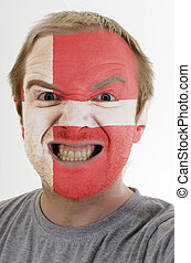 Face of crazy angry man painted in colors of denmark flag -...