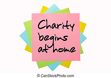 "text ""Charity begins at home"" written by hand font on bunch of colored sticky notes"