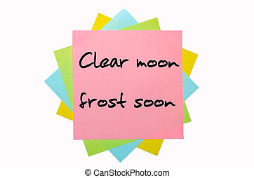 "text ""Clear moon, frost soon"" written by hand font on bunch of colored sticky notes"