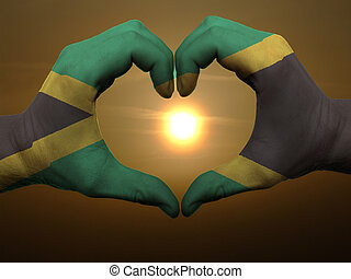 Gesture made by jamaica flag colored hands showing symbol of...