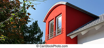 house with red dormer - detail of a house with modern red...