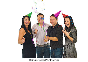 Happy friends open streamers at party - Happy friends having...