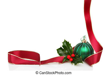 Christmas border or frame of red ribbon, green glass bauble...