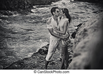 Loving couple hugging in black and white