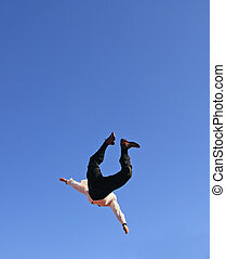 flying businessman - image of a man in a suit flying high in...