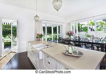 Kitchen and Dining area - Stylish open kitchen with large...