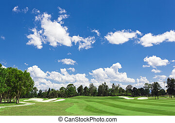 Sunny Golf Green - Sunny golf green with scattered clouds on...