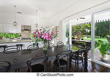 Dining area and kitchen overlooking a golf course - Stylish...