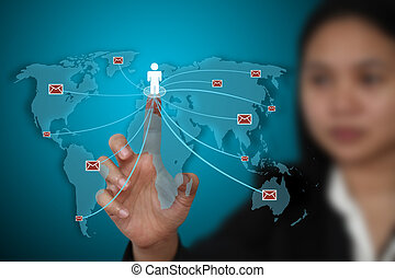 send mails - business woman send e-mail to the world for...