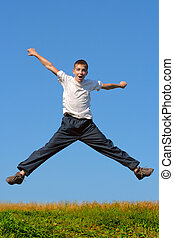 wow! - Happy and winning boy jumping on the blue sky...
