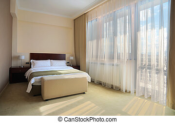 Bedroom for two - Interior of a hotel bedroom, with double...