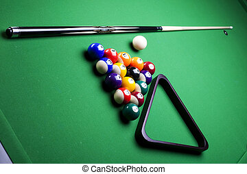 Billiard balls, cue on green table - Billiard table and...