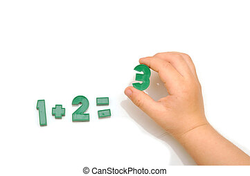 number fridge magnets, hand holding the number 3