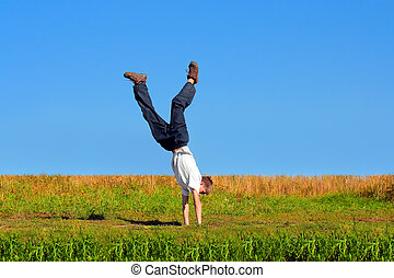 walk on arms - Somersault on grass on the blue sky...