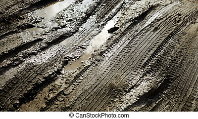 Tracks in the mud - Tire patterns on the mud with reflection...
