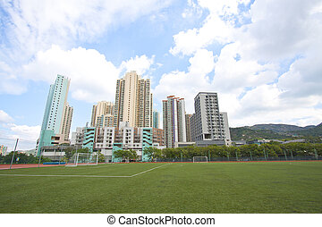 Hong Kong downtown with residential buildings and sports...