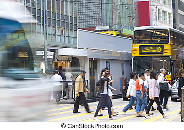 Busy pedestrian in business district, blurred motion.