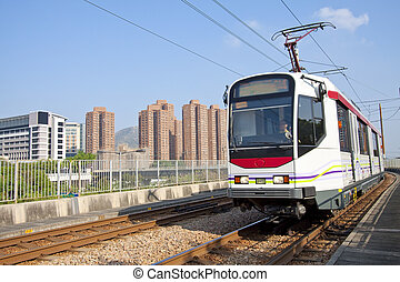 Moving train in Hong Kong at day