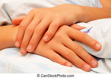 hands - Hands folded on the bed