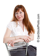 red-haired woman sitting in a chair