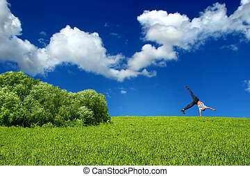stand on arm - Somersault on grass on the blue sky...