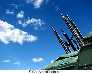 weapons - A large caliber machine-gun on the blue peaceable...
