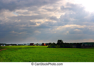village landscape - Dramatic cloudscape over village...