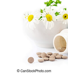 dietary supplements concept. Chamomile and close-up of...